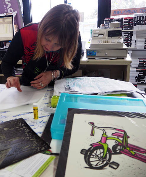Shana James linocut tricycle